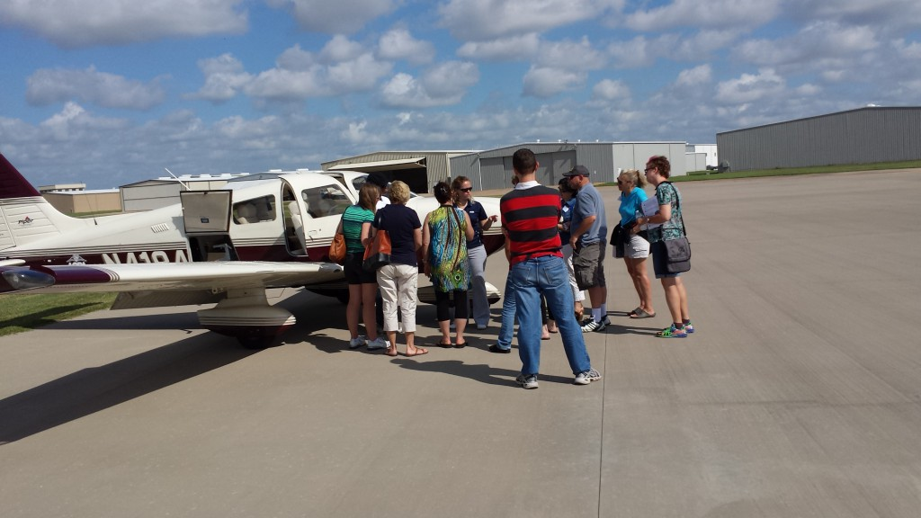 Attendees learning about pre-flights and parts of an airplane
